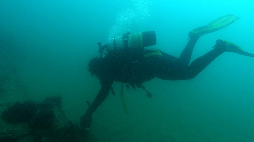 Diver inspecting outfall pipe