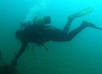 Scientific Diver inspecting outfall pipe
