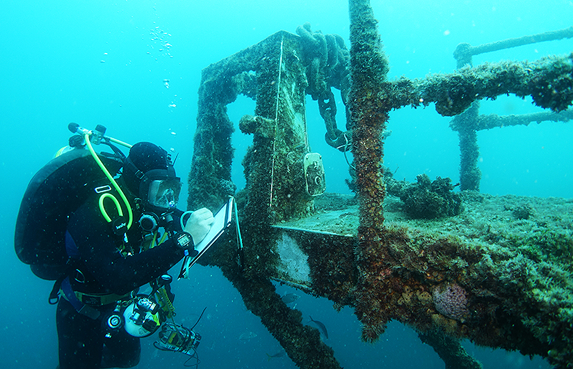 Professional diver performing a structural integrity assessment on the ex HMAS Hobart