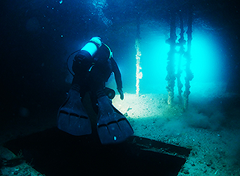 Commercial diver inside the ex HMAS Hobart