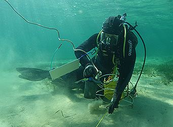 Diver with measuring equipment